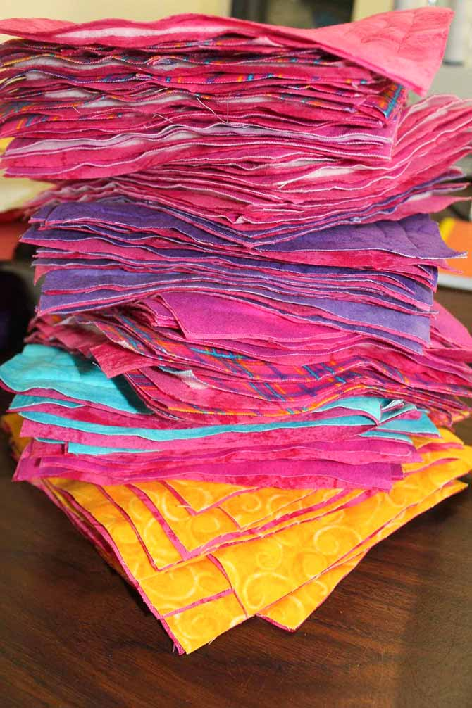 Stack of quilted blocks for the rag quilt