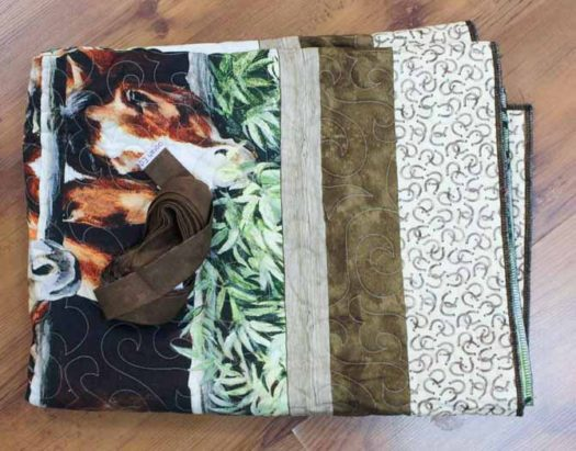 Quilt, with the binding ready to be stitched in place by sewing machine