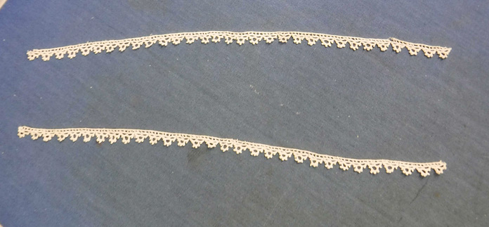 Two pieces of lace ready to be used as an embellishment
