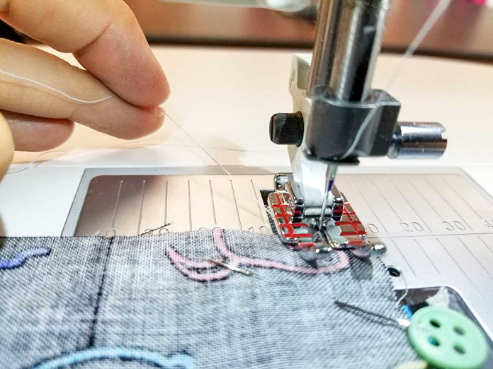 Hold the threads when you're starting a new line of stitching