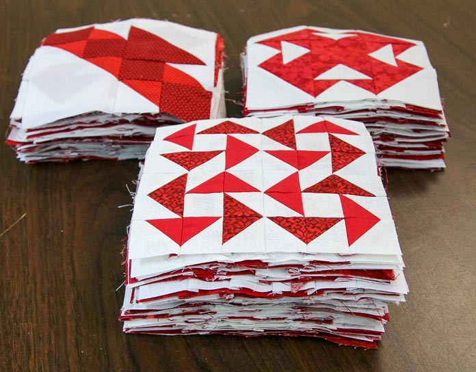 "150 red/white blocks measure 6"" square when finished."
