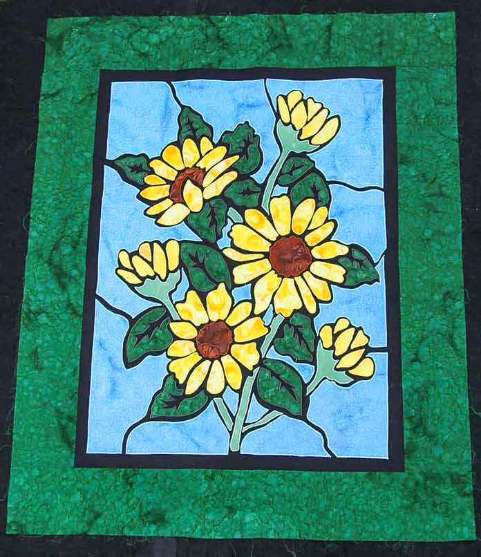 The sunflower wallhanging is basted and ready to be quilted.