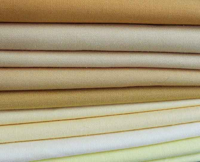 Northcott ColorWorks Premium Solids in shades of yellow