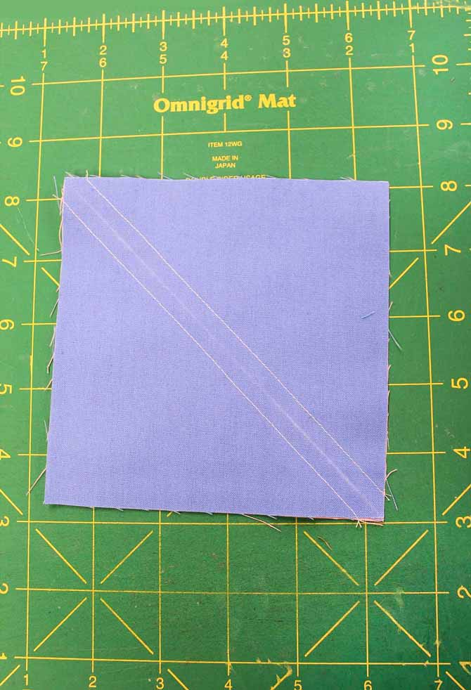 Draw a diagonal line and stitch a scant ¼ʺ on either side.