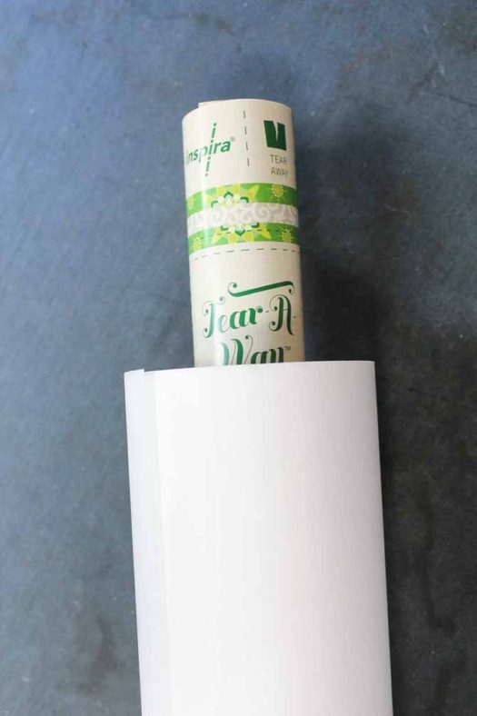 Insert the stabilizer label inside the roll of stabilizer