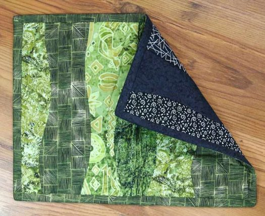 One finished placemat with reversible binding.