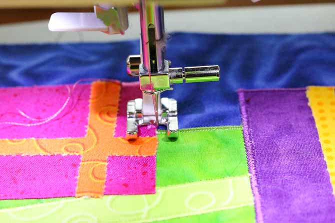 Stitch the applique from the bottom layers to the top layers