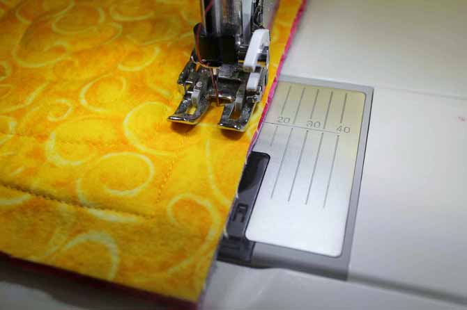 Use the guidelines on the stitch plate to get a consistent seam allowance