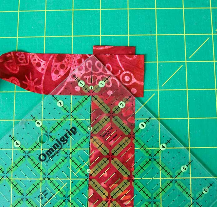 Using the 45-degree line on the ruler to draw my line for the diagonal seam