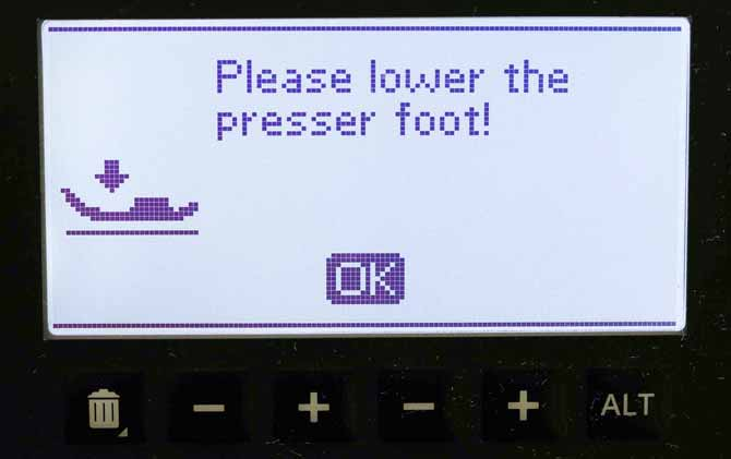 Message on the graphic display to lower the presser foot