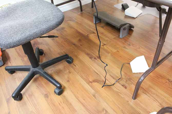 Sewing machine foot pedal in its usual spot - several feet away from the chair