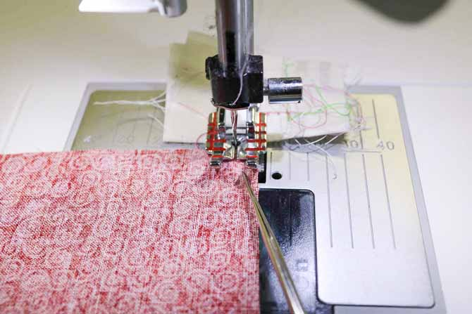 "The presser is raised ⅛"" making it easy to get the leading edge of the fabric right up to the needle. The quilter's awl helps to keep the two pieces from shifting."