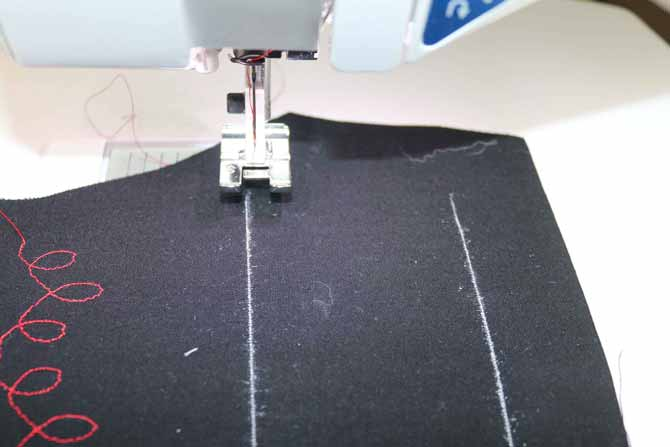 A chalk line provides a guide to follow for the side-motion stitches