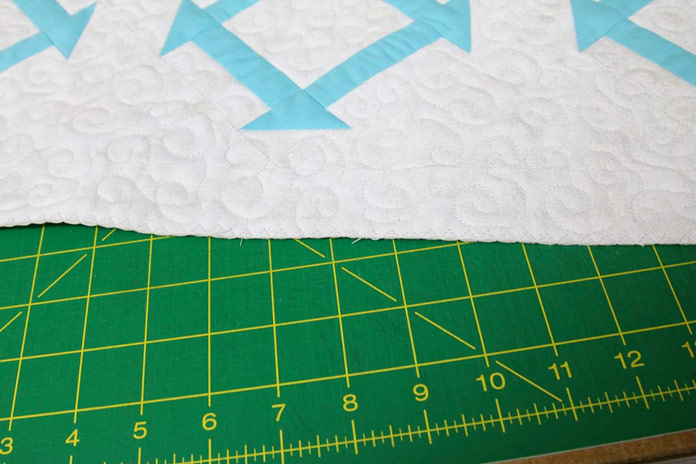 The edge of the table runner has been closed up using a three-step zigzag