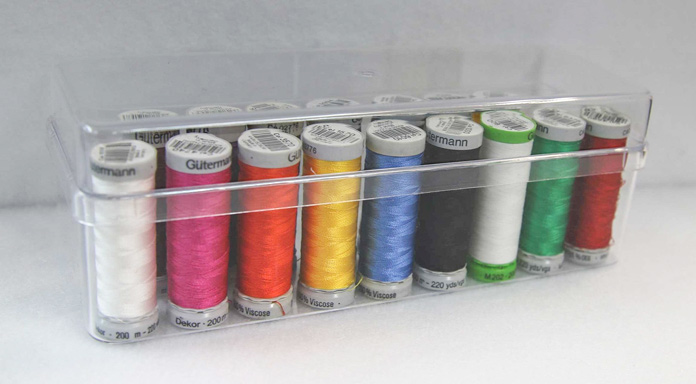 A handy plastic case holds 26 small spools of thread