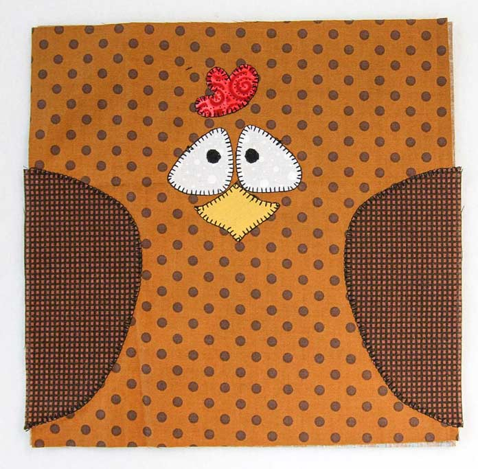 The blanket stitching is complete on the chicken pot holder