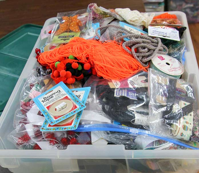 A well-stocked tub of embellishing supplies