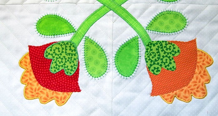 A variety of applique stitches were used to applique the flowers and leaves in place
