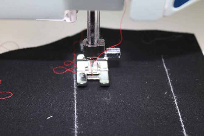 The fabric moves left and right as the sewing machine sews the side-motion stitches