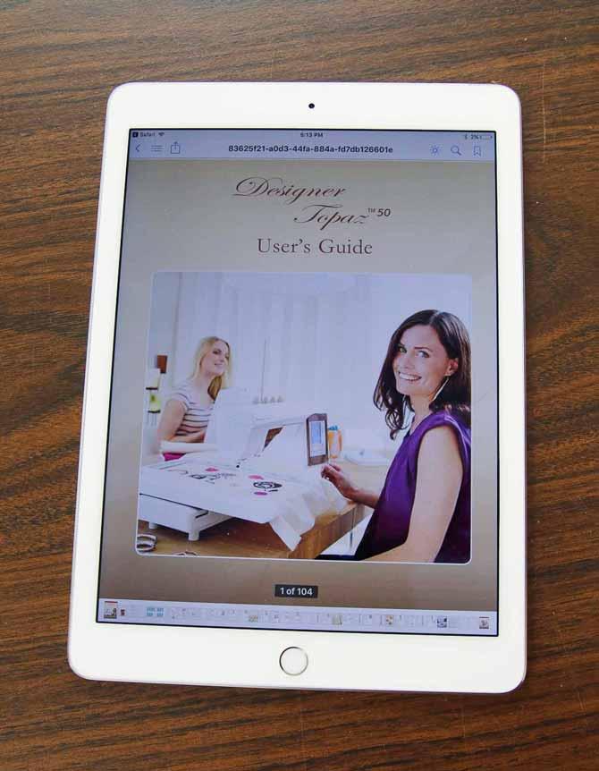User's Guide for the Designer Topaz 50 on a tablet on the Husqvarna Viking Designer Topaz 50