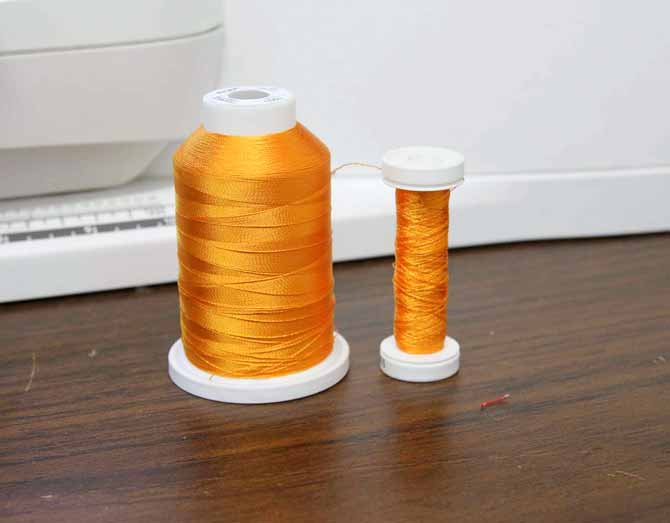 Two different spool sizes of thread
