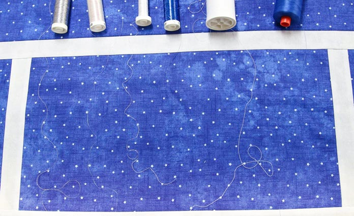Various thread choices for the snowman table runner