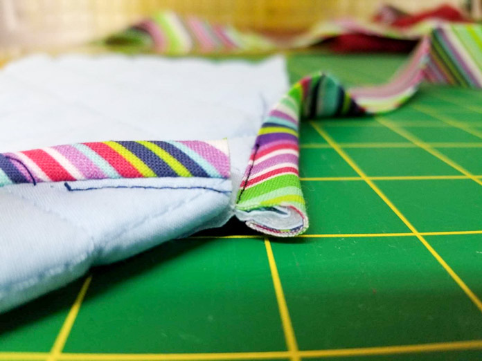 The quilt completely fills the binding