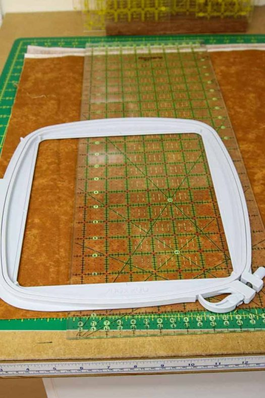 Using the hoop to cut a piece of fabric for the quilt label