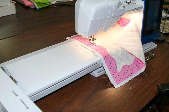 The embroidery unit is still attached while I'm doing my applique; using the HUSQVARNA VIKING Designer Brilliance 80 sewing machine