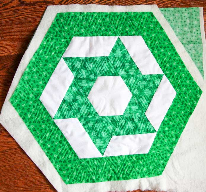 The green parts of the table topper are quilted
