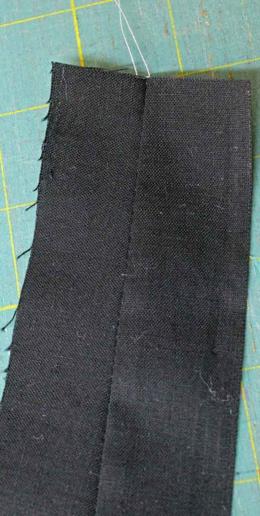 Grey thread doesn't show up on black fabric, meaning the tension is working very well