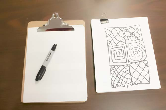 Clipboard and a Sharpie - a great way to practice free motion quilting
