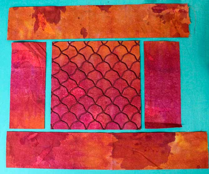 From the remainder of the VERY mottled over dyed muslin, I cut two side pieces and the top and bottom strips.