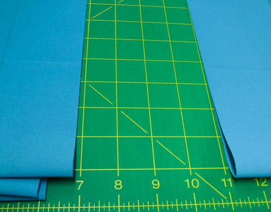 Keep the fold in the fabric close to you when cutting from yardage