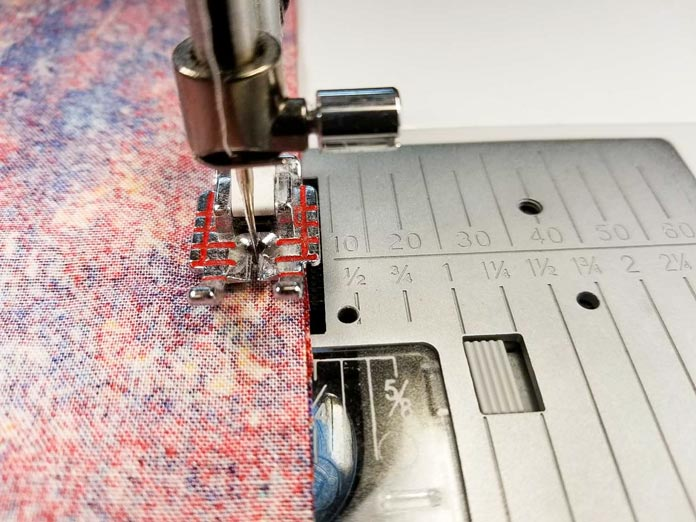 "Use the edge of the ¼"" piecing foot as the guide for the seam allowance"