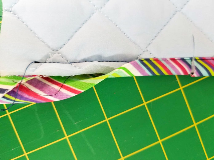 """Binding is stitched to the sample using a ¼"""" seam allowance."""
