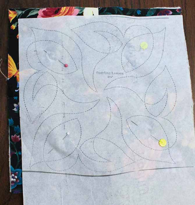 Quilt design on onion skin paper pinned to the quilt block