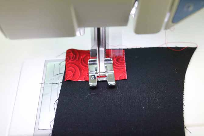 Sewing machine is stitching backwards onto the fabric square