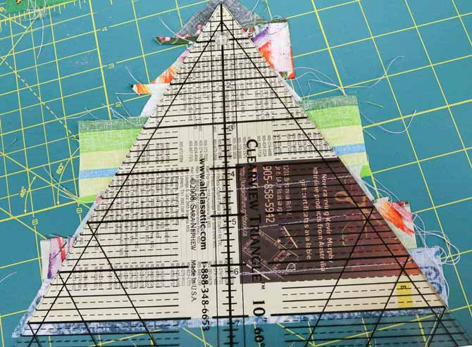 Use a 60-degree ruler to trim the triangles
