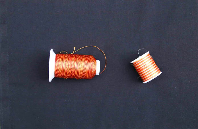 Two different brands of orange variegated thread