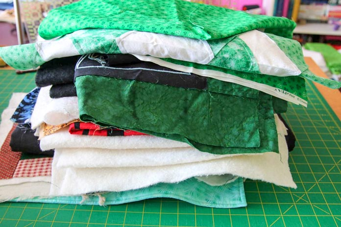 A stack of prepped projects that need to be quilted