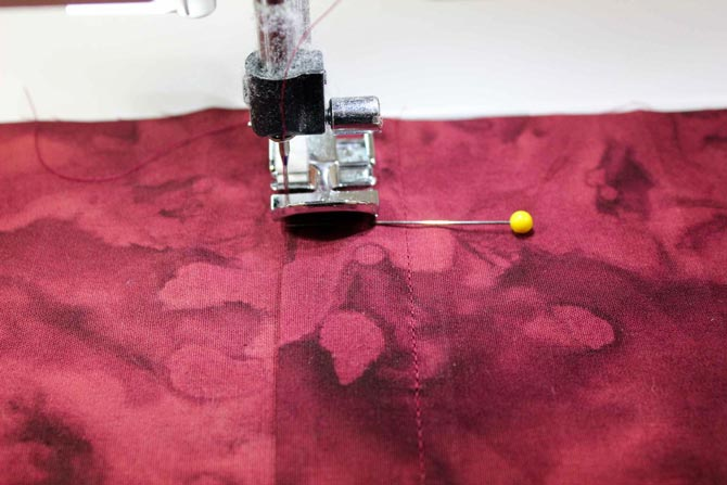 To sew the L shaped seam on the other side, you can change the zipper foot so it will stitch on the other side or mark with a pin so you know how far down to sew before you pivot.