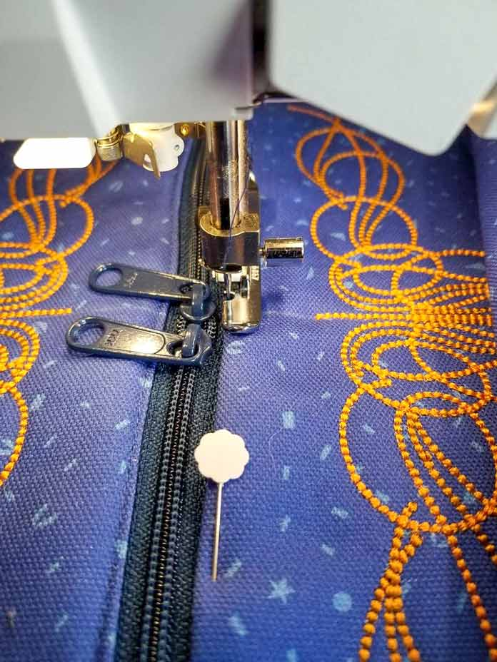Move the zipper slides away from the zipper foot for straighter lines of stitching