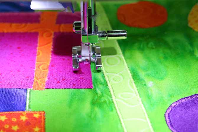 99% of the satin stitch rests on the applique shape