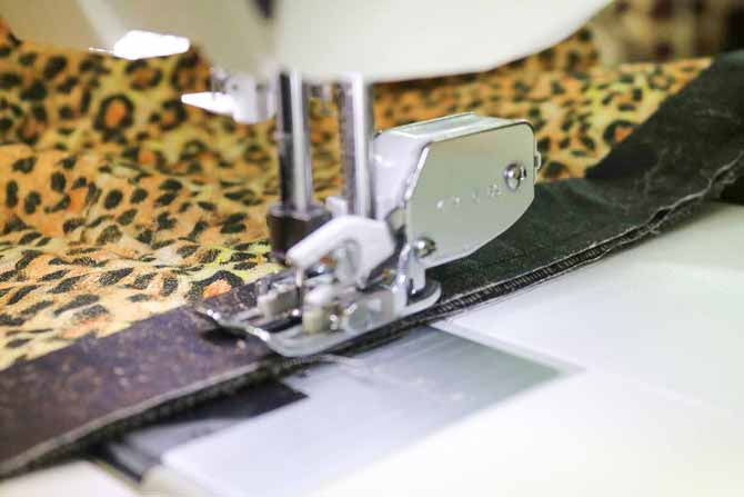 Using the walking foot to sew on a binding