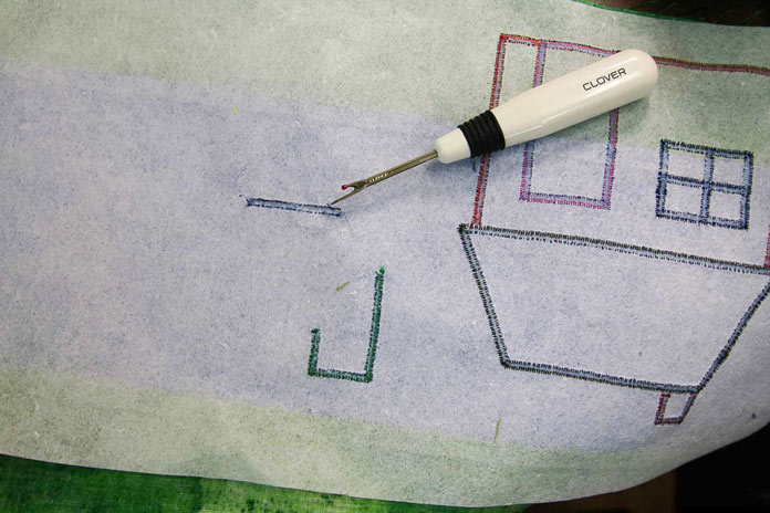 Slit the back of the stitches to easily remove satin stitching