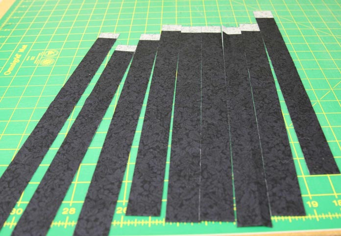 "Binding strips cut at 1¼"" for one side of the reversible binding."