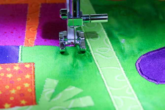 Needle is in the project at the outer most corner of the applique shape - ready to pivot