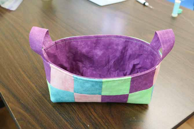 Basket with a topstitched edge around the top