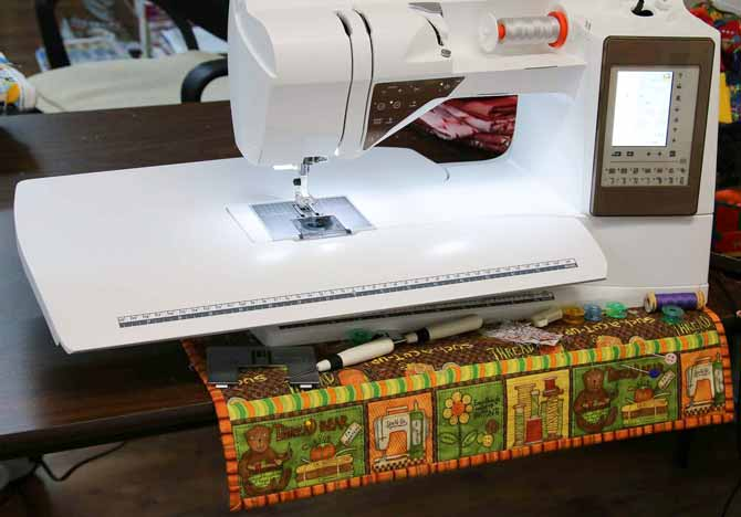 Review of the Husqvarna Viking Topaz 50 - Sewing caddy positioned under the Designer Topaz 50